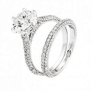 Brilliant cut diamond ring & matching diamond set wedding band