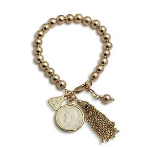 Von Treskow ball bracelet with a shilling charm & tassel
