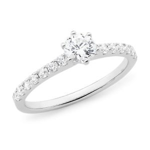 Diamond solitaire with should set diamond band