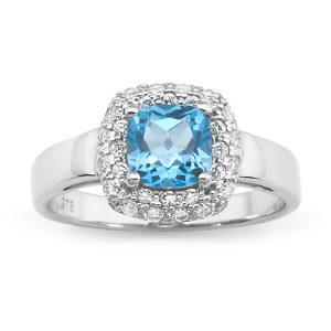 Blue topaz & diamond halo ring