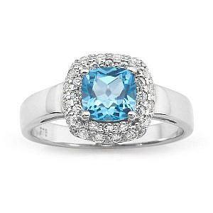 Blue topaz & diamond halo ring