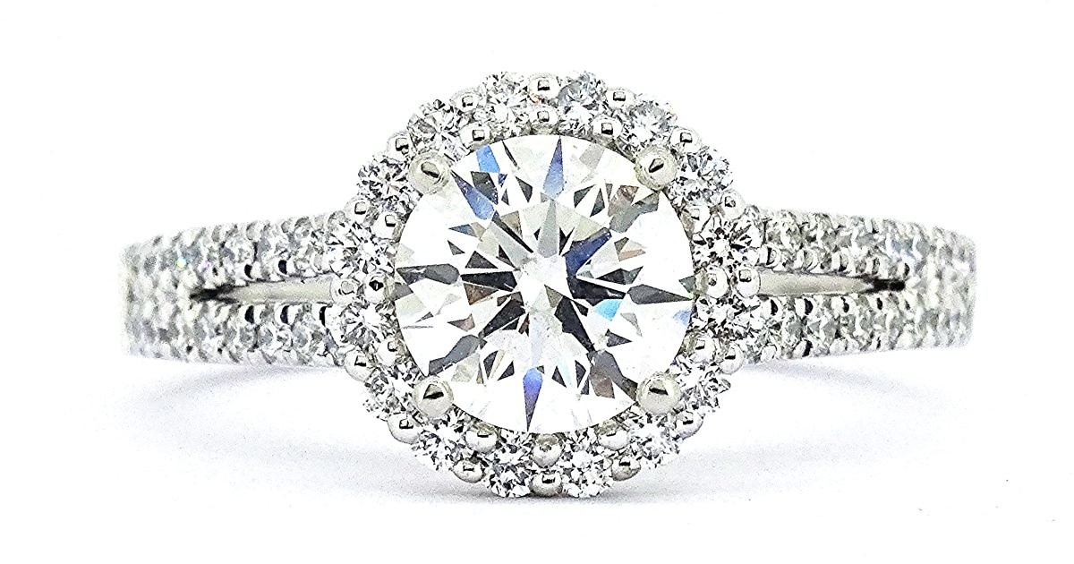 We love David & Malinda's 1.3CT Round Diamond Halo Ring